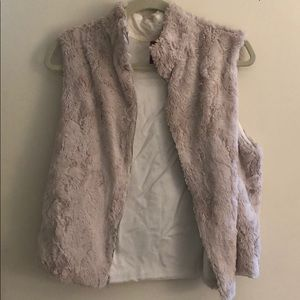 Tan fur vest. Lightly worn but looks new